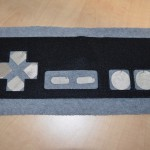Plush game controller with capacitive touch pads